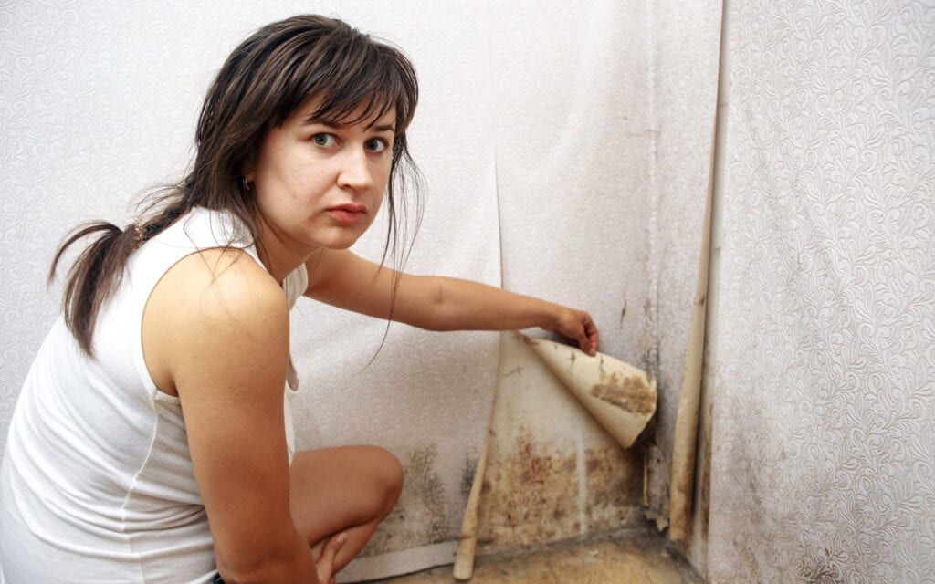 Woman showing black mold